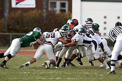 10 November 2007:  Marcus Dunlop gets stacked up by the Thunder. This game between the Wheaton College Thunder and the Illinois Wesleyan University Titans was for a share of the CCIW Championship and was played at Wilder Field on the campus of Illinois Wesleyan University in Bloomington Illinois.