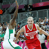 02 August 2012: Russia Anton Ponkrashov drives past Brazil Larry Taylor during 75-74 Team Russia victory over Team Brazil, during the men's basketball preliminary, at the Basketball Arena, in London, Great Britain.