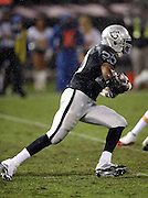 Oakland Raiders running back Darren McFadden (20) runs the ball in a driving rain storm during the NFL week 12 regular season football game against the Kansas City Chiefs on Thursday, Nov. 20, 2014 in Oakland, Calif. The Raiders won their first game of the season 24-20. ©Paul Anthony Spinelli