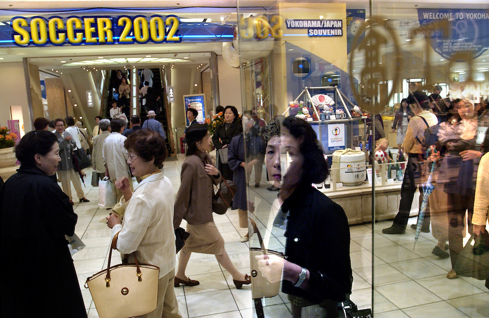 Yokohama's Takashimaya department store displays World Cup souvenirs as Japanese shoppers wait for friends near the front of the building. Yokohama, Japan 27/06/02..©David Dare Parker/AsiaWorks Photography