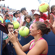 Sara Errani, Italy, signs autographs after her victory against Angelique Kerber, Germany, during the US Open Tennis Tournament, Flushing, New York. USA. 3rd September 2012. Photo Tim Clayton