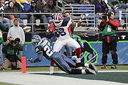 SEATTLE - NOVEMBER 28:  Wide receiver Lee Evans #83 of the Buffalo Bills scores a touchdown for a 17-3 lead on a 3 yard pass near the end of the first half against cornerback Marcus Trufant #23 of the Seattle Seahawks at Qwest Field on November 28, 2004 in Seattle, Washington. The Bills defeated the Seahawks 38-9. ©Paul Anthony Spinelli *** Local Caption *** Lee Evans; Marcus Trufant