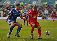 Photo: Tony Oudot/Richard Lane Photography. <br /> Gillingham Town v Carlisle United. Coca-Cola League One. 21/03/2008. <br /> Simon Hackney of Carlisle beats Garry Richards of Gillingham to the ball