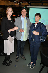 Left to right, ? artist SIMON PERITON and SADIE COLES at Fork to Fork - a Fundraising Feast to support The Open Air Classroom Project held at The Dock Kitchen, Portobello Docks, 342-344 Ladbroke Grove, London on 19th May 2015.