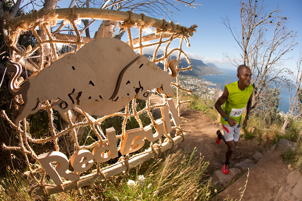 Thabang Madiba heads up the stairs during the Red Bull Lion Heart, on Lions Head, Cape Town, South Africa, 9 November 2013
