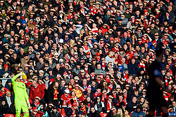 LIVERPOOL, ENGLAND - Saturday, February 24, 2018: Liverpool supporters shield their eyes from the sun during the FA Premier League match between Liverpool FC and West Ham United FC at Anfield. (Pic by David Rawcliffe/Propaganda)