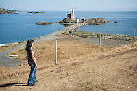 Female Tourist Looking at Fisgard Lighthouse, Fort Rodd Hill National Historic Site, Vancouver Island, B.C.