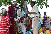Bwindi Community Hospital medical staff run an out reach clinic in Kitahurira, the only Batwa tribe settlement in Mpungu district. As well as nutrition and vaccination programs they also monitor all the babies health. Rev Sam head of the Bwindi Community Hospital outreach program weighs each of the children attending. The Hospital provides different outreach clinics everyday for the surrounding area around Buhoma. The Mpungu district is on the edge of the Bwindi Impenetrable Forest, Western Uganda.