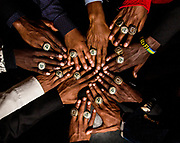 Former and current members of the Clarkston High School cross country team show off their rings at the ring ceremony for the team's 2016 state championship victory at Clarkston High School in Clarkston, Georgia, on Thursday, April 13, 2017. The current varsity cross country team is composed entirely of students who are African refugees or immigrants. The team has won the state championships for the past three years in a row. (Photo/Casey Sykes for ESPN)