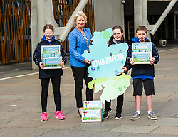 Pictured: Lucy Beeston (pony tail 11), Fay Turpie Laird (11) and Sorley Scott (10) joined Roseanna Cunningham to protest for zero climate emmissions<br /> Cabinet secretary for Environment, Climate Change and Land Reform, Roseanna Cunningham, MSP, joined pupils from Sceines Primary School outside the Scottish Parliament to support the campaign to reduce climate emissions to zero by 2050<br /> <br /> <br /> Ger Harley | EEm 20 September 2017