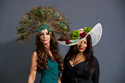 LIVERPOOL, ENGLAND - Thursday, April 6, 2017: Essy Van Der Vlies [L], 44 from The Netherlands, wearing Valery's Vintage dress and a peacock fascinator from House of Charles, and hat designer Janice Charles, during The Opening Day on Day One of the Aintree Grand National Festival 2017 at Aintree Racecourse. (Pic by David Rawcliffe/Propaganda)