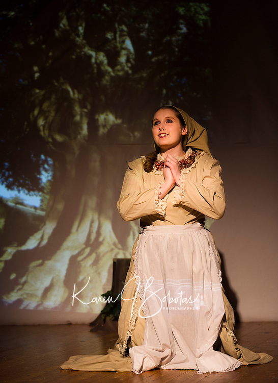 """Sabrina Desaulniers (Cinderella) makes a wish under the tree during dress rehearsal for """"Into The Woods"""" at Laconia High School Wednesday afternoon.  (Karen Bobotas/for the Laconia Daily Sun)"""