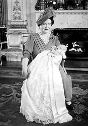 File photo dated 15/12/1948 of the Queen Mother holding her first grand child Prince Charles at his christening at Buckingham Palace.