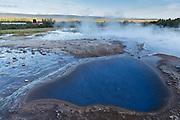 Bioluminescent, geothermal pool next to the Strokkur geyser, in Thingvellir National Park, Iceland.