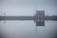 Thick fog shrouds the mill pond in Emsworth, Hampshire today. The weather forced many flights to be cancelled across the United Kingdom.<br /> Picture date Monday 2nd November, 2015.<br /> Picture by Christopher Ison. Contact +447544 044177 chris@christopherison.com