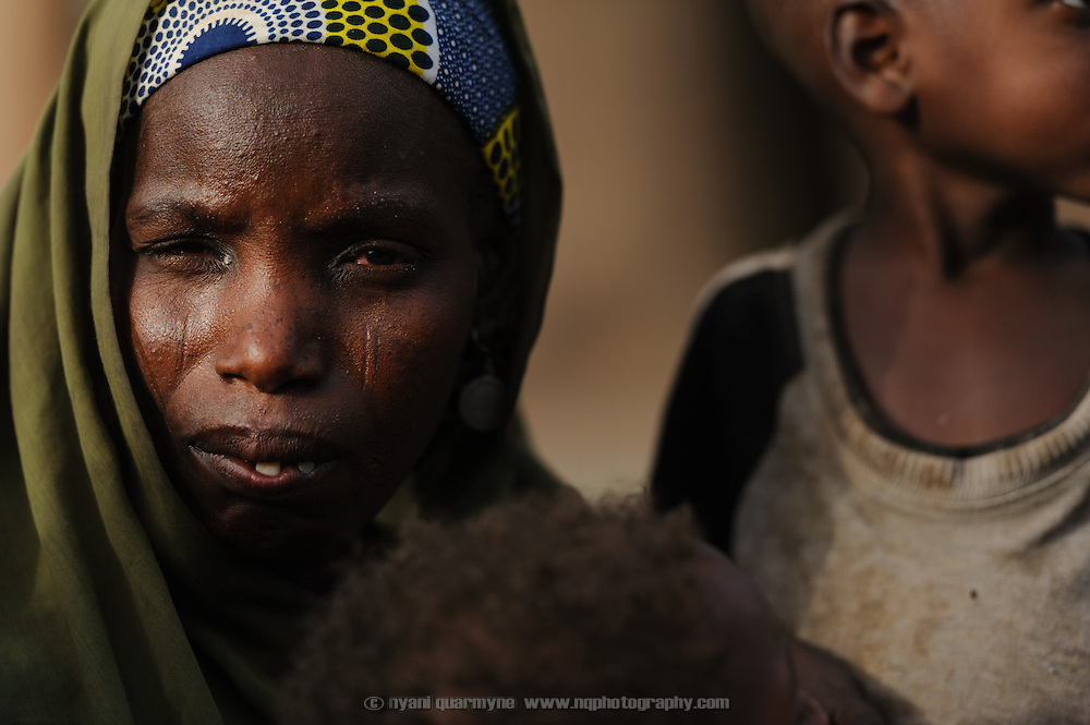 Adama Garba, mother of six, including malnourished twin girls, Hassana and Oussaina Souley (14 months), at her home in the village of Nakaidabo in the Tessaoua region of Niger.