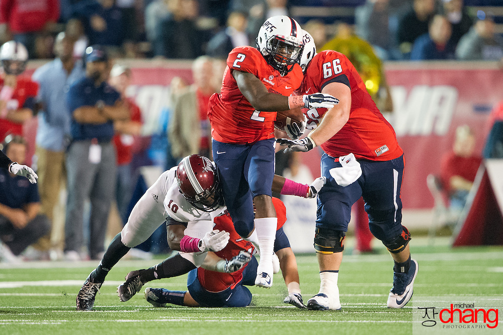 MOBILE, AL - OCTOBER 24: Running back Terrance Timmons #2 of the South Alabama Jaguars attempts to escape a tackle by cornerback Dondrell Harris #10 of the Troy Trojans on October 24, 2014 at Ladd-Peebles Stadium in Mobile, Alabama.  The South Alabama Jaguars defeated the Troy Trojans 27-13. (Photo by Michael Chang/Getty Images) *** Local Caption *** Terrance Timmons; Dondrell Harris