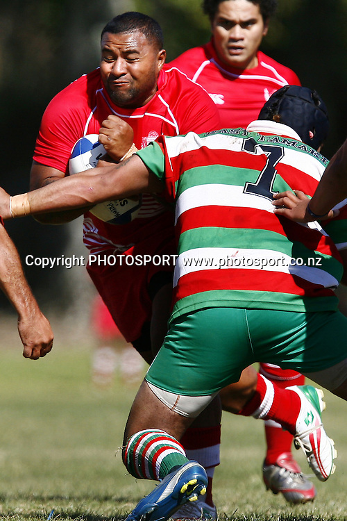 Papatoetoe's Sanele Mikaele charging into a tackle from East Tamaki's Lotu Faaui during the Auckland Premier Club Rugby match, East Tamaki v Papatoetoe at East Tamaki Domain, Auckland, New Zealand. Saturday 4 April 2009. Photo: Anthony Au-Yeung/PHOTOSPORT