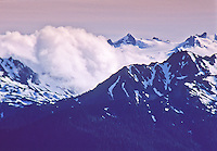 Clouds drifting over  Mount Olympus, Olympic National Park, Washington, USA.