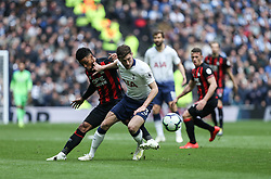 Ben Davies of Tottenham Hotspur and Elias Kachunga of Huddersfield Town tussle for the ball - Mandatory by-line: Arron Gent/JMP - 13/04/2019 - FOOTBALL - White Hart Lane - London, England - Tottenham Hotspur v Huddersfield Town - Premier League