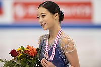 KELOWNA, BC - OCTOBER 26: Ladies bronze medalist, Young You of Korea shows her medal on the ice during medal ceremonies of Skate Canada International held at Prospera Place on October 26, 2019 in Kelowna, Canada. (Photo by Marissa Baecker/Shoot the Breeze)