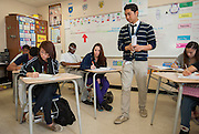 Albert Wei teaches a 12th grade economics class at Sharpstown High School, May 17, 2013.