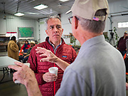 """24 JANUARY 2020 - POLK CITY, IOWA: JOE WALSH, (red jacket) talks to RAY MEYLOR about regenerative agriculture on Meylor's farm in Polk City, northwest of Des Moines. Walsh, a conservative radio personality, former Republican congressman, and one time supporter of Donald Trump is now challenging Trump for the Republican nomination for the US Presidency. During his appearance in Polk City, Walsh said Trump is unfit to be the President because he is a """"cheater,"""" a climate change denier, and a """"threat"""" to the United States.      PHOTO BY JACK KURTZ"""