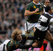 Twickenham, GREAT BRITAIN, Francois STEYN with a low tackle on Jason ROBINSON,  during the, Gartmore Challenge -  Barbarians vs South Africa, rugby match at Twickenham Stadium, ENGLAND.  [Mandatory Credit Peter Spurrier/Intersport Images].
