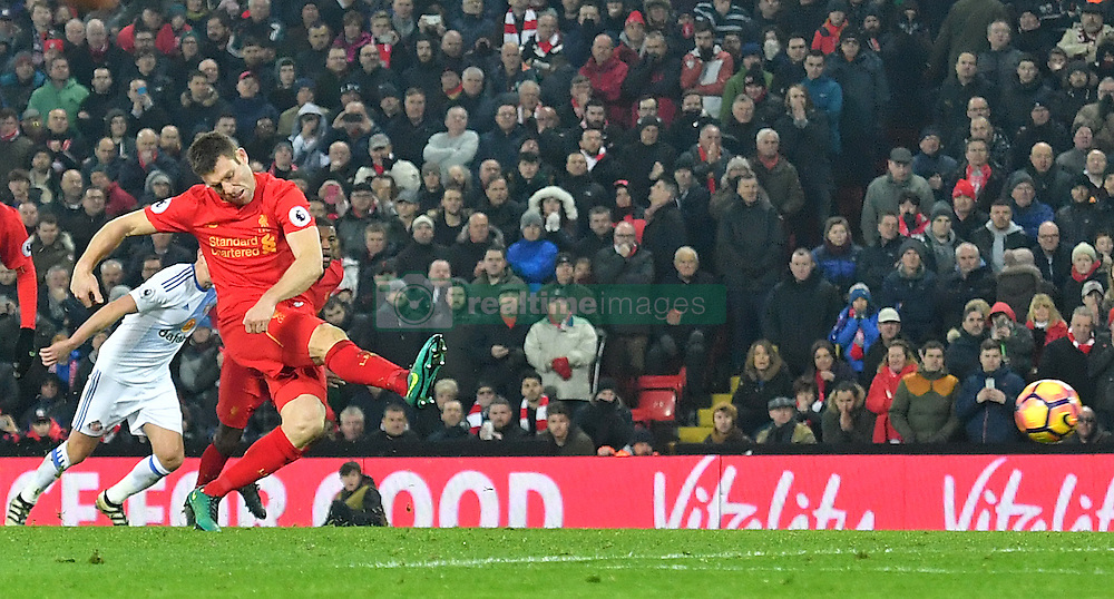 Liverpool's James Milner scores his side's second goal from the penalty spot during the Premier League match at Anfield, Liverpool.