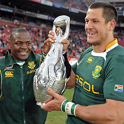 Pierre Spies and Chiliboy Ralepelle of the South Africa with the 2009 Lions Series Trophy during the British and Irish Lions tour 2009