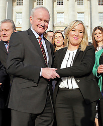 © Licensed to London News Pictures. STORMONT BELFAST - 23 JAN 2017: Sinn Fein's Michelle O'Neill  shakes hands with Martin McGuinness, on the steps of Stormont after being named as the new leader of Sinn Fein in the North, taking over from former deputy first minister Martin McGuinness who has retired due to illness. Photo credit: London News Pictures.