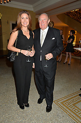 ANDREW NEIL and SUSAN NILSSON at a reception to celebrate the Debrett's 500 2015 - a recognition of Britain's 500 most influential people, held at The Club at The Cafe Royal, 68 Regent Street, London on 26th January 2015.
