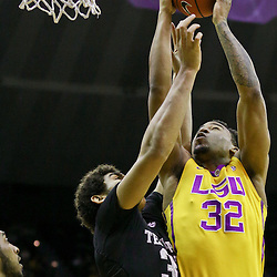 Feb 13, 2016; Baton Rouge, LA, USA; LSU Tigers forward Craig Victor II (32) shoots over Texas A&M Aggies center Tyler Davis (34) during the first half of a game at the Pete Maravich Assembly Center. Mandatory Credit: Derick E. Hingle-USA TODAY Sports