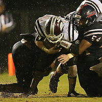 Lauren Wood   Buy at photos.djournal.com<br /> Baldwyn's Jacob Harper and Marquavious Patterson tackle Eupora's Jack Smith during Friday night's game at Baldwyn.