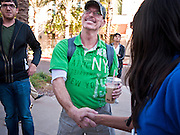 14 OCTOBER 2011 - SCOTTSDALE, AZ:   The first person in line for the new iPhone 4S is congratulated by an Apple Store employee at the Apple Store in the Scottsdale Quarter. Hundreds of people lined up at the Apple Store in the Scottsdale Quarter in Scottsdale, AZ, Friday, Oct. 14, to buy the iPhone 4S. The phone sold out in pre-orders last week and sales at the Scottsdale Apple Store were brisk through the morning.   PHOTO BY JACK KURTZ