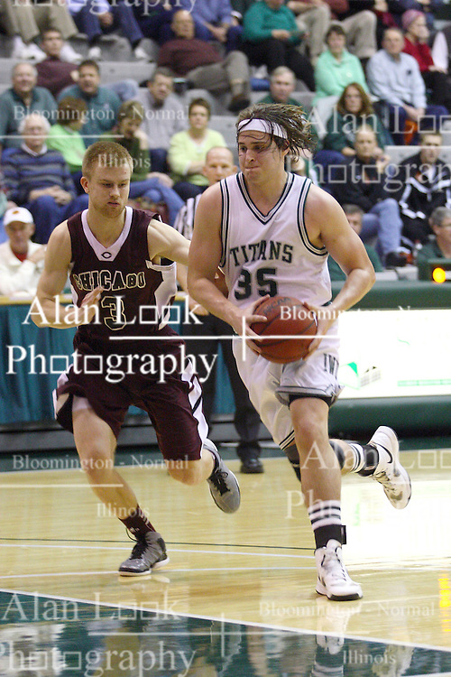 15 December 2012:  Andrew Ziemnik works against Charlie Hughes during an NCAA mens division 3 basketball game between theUniversity of Chicago Maroons and the Illinois Wesleyan Titans in Shirk Center, Bloomington IL