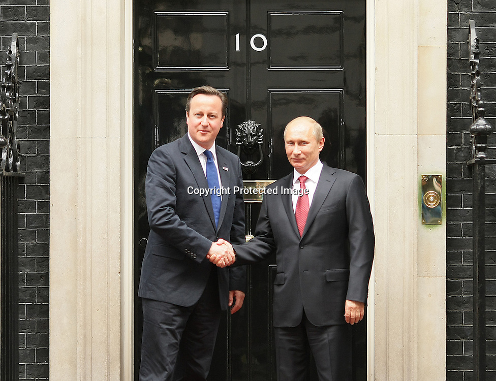 Russian President Vladimir Putin Greets British Prime Minister David Cameron outside 10 Downing Street in central London, on 2/08/2012. Photo By i-Images.