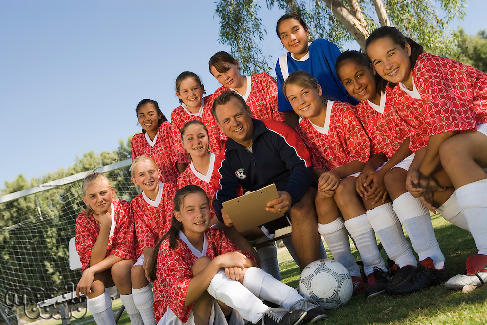 Coach with Girls Soccer Team