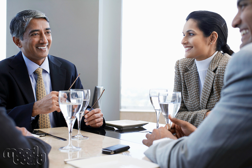 Business associates smiling having business meeting