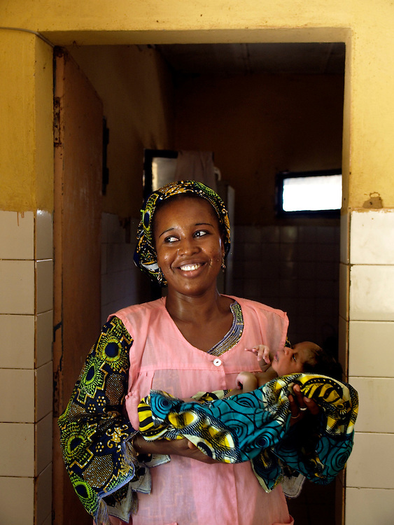 Safi Insa Moussa - the midwife in charge in Bande holds newborn baby boy Muhammed. She is the only midwife but several traditional birth attendants work with her. interviewed by Joanna.