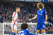 David Luiz (Chelsea) talks with James McArthur (Crystal Palace) after Willian (Chelsea) was tackled to the ground by McArthur during the Premier League match between Chelsea and Crystal Palace at Stamford Bridge, London, England on 4 November 2018.