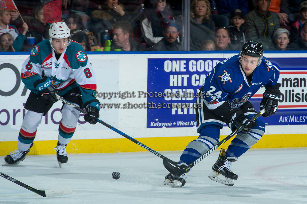 KELOWNA, CANADA - FEBRUARY 12:  Jack Cowell #8 of the Kelowna Rockets skates for the puck against Lane Zablocki #24 of the Victoria Royals on February 12, 2018 at Prospera Place in Kelowna, British Columbia, Canada.  (Photo by Marissa Baecker/Shoot the Breeze)  *** Local Caption ***