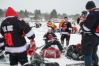 """Jason Puliere """"King Hooper"""" and TJ Pompey """"Kirby"""" of the Super Smashed Bros team in the Shinny 35+ division take a break in between games during day one of the New England Pond Hockey Classic on Lake Waukewan Friday.  (Karen Bobotas/for the Laconia Daily Sun)"""
