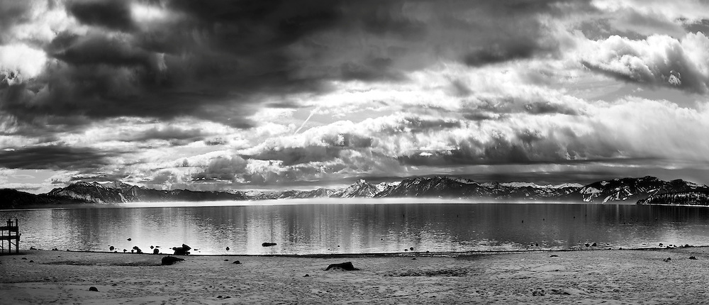 """""""Winter Storm at Tahoe Vista 1"""" - A black and white photograph of a clearing winter storm taken from Tahoe Vista Beach in North Lake Tahoe"""