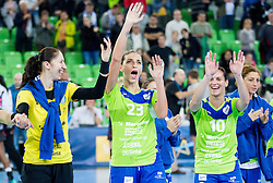 Talida Tolnai #21 of RK Krim Mercator, Andrea Penezic #23 of RK Krim Mercator and Andjela Bulatovic #10 of RK Krim Mercator celebrate after winning the handball match between RK Krim Mercator (SLO) and  Metz Handball (FRA) in 4th Round of Women's Champions League on November 2, 2013 in Arena Stozice, Ljubljana, Slovenia. (Photo by Vid Ponikvar / Sportida)