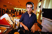 DJ Alex Kidd DJ'ing at Agnes B shop London August 2001