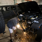 DORAL, FLORIDA, DECEMBER 11, 2015<br /> Alberto Faraldo removes a front bumper from a Jeep Wrangler as he customizes the vehicle in the garage of The Auto Firm, a South Florida car customizing and restoring shop which has a vast clientele of professional athletes and entertainers.<br /> (Photo by Angel Valentin/Freelance)