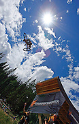 Byron Hetzler/Sky-Hi News.Greg Watts launches from a jump during slopestyle qualification at Crankworx Colorado on Friday at Winter Park Resort.