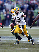 Green Bay Packers quarterback Aaron Rodgers (12) points as he throws a late fourth quarter pass during the NFL week 20 NFC Championship football game against the Seattle Seahawks on Sunday, Jan. 18, 2015 in Seattle. The Seahawks won the game 28-22 in overtime. ©Paul Anthony Spinelli
