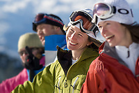 A group of skiers pause and laugh during a ski day on Blackcomb Mountain, in Whistler, BC Canada